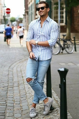 How to wear: light blue vertical striped dress shirt, light blue ripped skinny jeans, grey low top sneakers, black sunglasses