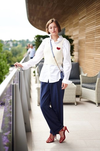 White Dress Shirt Outfits For Women: Marrying a white dress shirt and navy vertical striped dress pants is a fail-safe way to infuse your styling collection with some glamour. All you need now is a cool pair of red leather heeled sandals to finish this outfit.