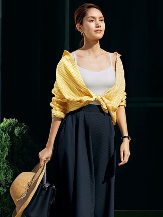 How to wear: yellow gingham dress shirt, white tank, black pleated midi skirt, black leather bucket bag