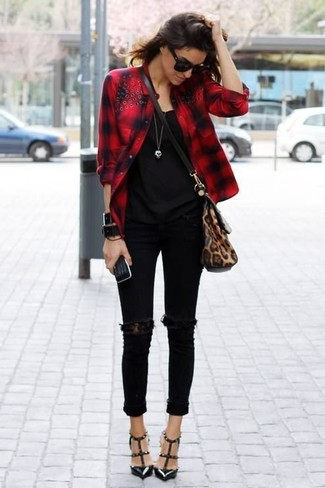 This combo of a red check button-up shirt and black ripped slim jeans is a safe bet for an effortlessly cool look. A pair of black studded leather pumps will seamlessly integrate within a variety of outfits.