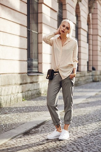 How to Wear Grey Tapered Pants For Women: A beige dress shirt and grey tapered pants? Make no mistake, this getup will make every jaw drop. Does this outfit feel too polished? Introduce white leather low top sneakers to change things up a bit.