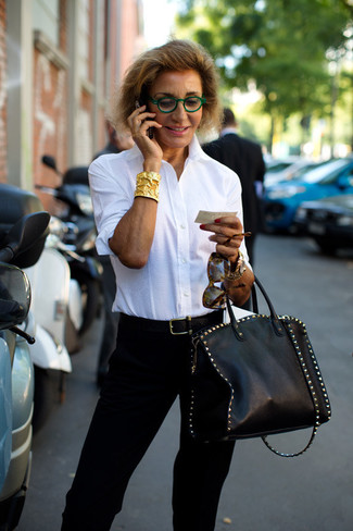 How to wear: white dress shirt, black tapered pants, black studded leather tote bag, black leather belt