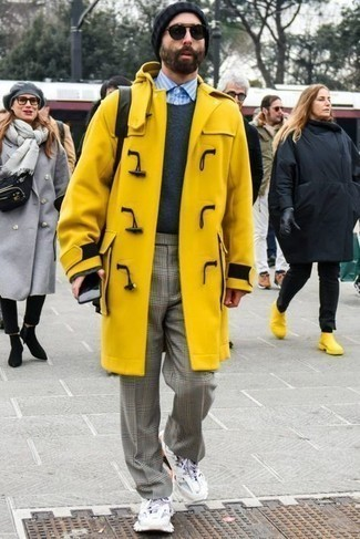 Mustard Duffle Coat Outfits For Men: Go for a mustard duffle coat and grey plaid chinos to don a sleek and elegant look. Bring a modern twist to this look with a pair of white athletic shoes.