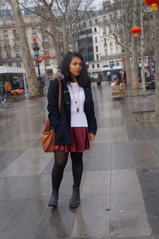 Consider teaming a duffle coat with an oxblood skater skirt for a lazy day look. Consider black leather chelsea boots as the glue that will bring your look together. This look is a wonderful option come warmer days.