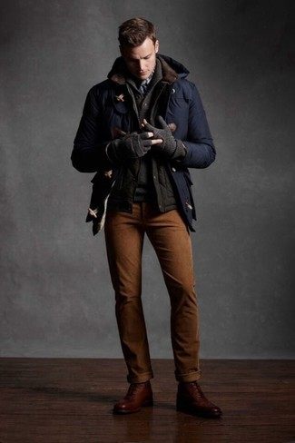 A Hugo Pratt Bareket Duffle Coat and brown chinos teamed together are a total eye candy for those who love polished styles. Look at how well this look pairs with brown leather brogue boots. During the colder months, when warmth is crucial, it can be easy to settle for a less-than-stylish getup. This look, however, proves that you totally can stay warm and remain equally stylish in the winter season.