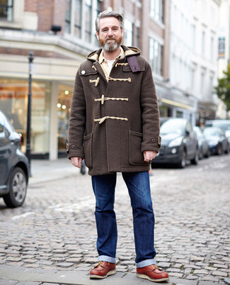 Fashion for Men Over 50: What To Wear: For an outfit that's nothing less than camera-worthy, make a dark brown duffle coat and blue jeans your outfit choice. Complete this ensemble with a pair of tobacco leather work boots to give a sense of stylish effortlessness to your outfit.