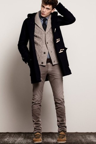 Dress in a Saint Laurent Western Duffle Coat and brown jeans for a work-approved look. Brown suede casual boots complement this look quite well. Seeing as temperatures are dropping, this outfit is a solid option for the time in between seasons.