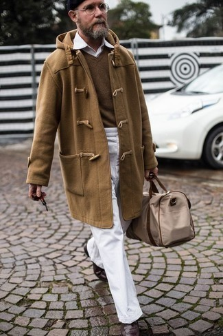 How to Wear Dark Brown Leather Brogue Boots: Reach for a camel duffle coat and white chinos to look sophisticated but not too formal. A good pair of dark brown leather brogue boots pulls this outfit together.