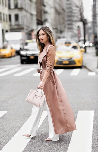Who said you can't make a style statement with a casual outfit? You can do so with ease in a neon pink duster and white wide leg pants. Look at how well this ensemble is round off with pale pink leather pumps. This ensemble is a good option when spring comes.