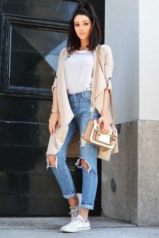 How to Wear Light Blue Ripped Boyfriend Jeans: Pair a beige duster coat with light blue ripped boyfriend jeans for a look that's both stylish and comfy. Introduce a pair of white canvas low top sneakers to the equation and ta-da: the outfit is complete.
