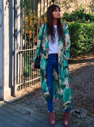 How to wear: green floral duster coat, white crew-neck t-shirt, blue ripped jeans, burgundy leather ankle boots