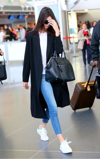 Step up your off-duty look in a black duster coat and blue skinny jeans. Want to go easy on the shoe front? Grab a pair of white low top sneakers for the day.