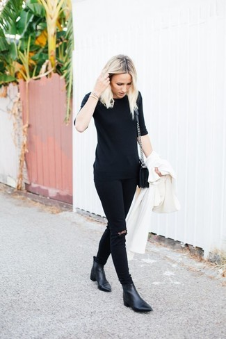 How to wear: white duster coat, black crew-neck t-shirt, black ripped skinny jeans, black leather ankle boots