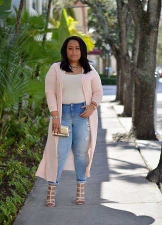 How to Wear Beige Leather Heeled Sandals: This pairing of a pink duster coat and light blue ripped skinny jeans is super easy to create and so comfortable to wear a variation of as well! Feeling bold today? Shake things up by sporting beige leather heeled sandals.