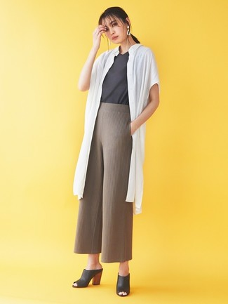 How to wear: white duster coat, charcoal crew-neck t-shirt, brown knit wide leg pants, black leather mules