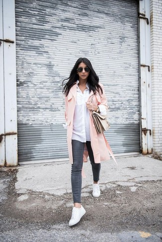 A hot pink duster coat and charcoal skinny jeans are a great outfit formula to have in your arsenal. To bring out the fun side of you, complete your outfit with white leather low top sneakers. This is a safe option for an awesome transition outfit.