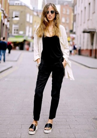 How to wear: white duster coat, black jumpsuit, black and white leather flat sandals, black sunglasses