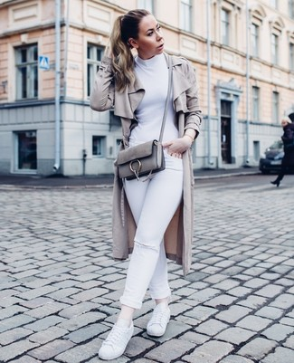 A grey duster coat and white ripped slim jeans are a great outfit formula to have in your arsenal. A pair of white leather low top sneakers brings the dressed-down touch to the ensemble.