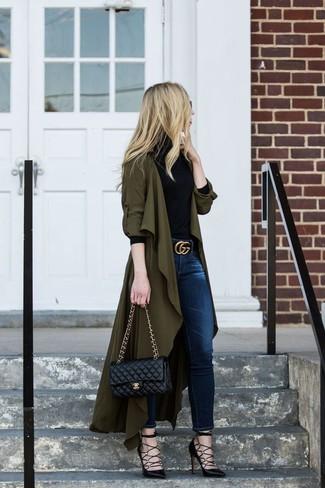 How to wear: olive duster coat, black turtleneck, navy skinny jeans, black leather pumps