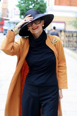 How to wear: orange duster coat, navy turtleneck, navy wide leg pants, black straw hat