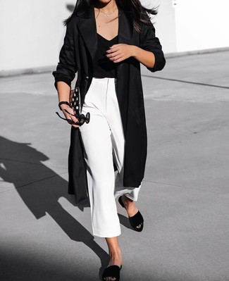 Marry a black duster coat with white culottes for both chic and easy-to-wear look. Throw in a pair of black suede flat sandals for a more relaxed aesthetic.