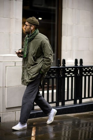 How to Wear Charcoal Wool Chinos: This combo of an olive field jacket and charcoal wool chinos is hard proof that a straightforward casual getup doesn't have to be boring. Complete this look with a pair of white canvas low top sneakers to bring a touch of stylish nonchalance to your getup.