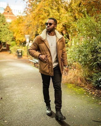 Beige Crew-neck Sweater Outfits For Men: A beige crew-neck sweater and black jeans are absolute menswear staples if you're crafting a casual closet that matches up to the highest sartorial standards. Go ahead and add a pair of charcoal leather casual boots to the equation for a sense of class.