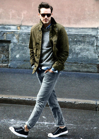 A blue long sleeve shirt with grey jeans has become an essential combination for many style-conscious men. Black low top sneakers are a savvy choice to complete the look.