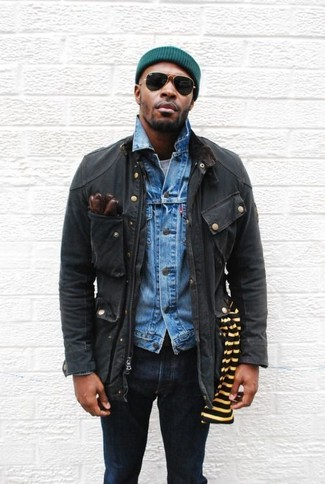 How to wear: black field jacket, blue denim jacket, grey crew-neck t-shirt, navy skinny jeans