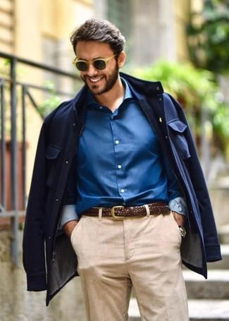 How to wear: navy field jacket, blue dress shirt, dark brown woven leather belt, tan sunglasses