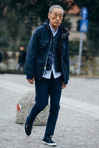 How to Wear a Gilet For Men: For manly elegance with a modern spin, make a gilet and navy dress pants your outfit choice. You could perhaps get a bit experimental on the shoe front and complement this look with navy canvas low top sneakers.