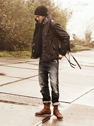 How to wear: dark brown field jacket, navy ripped jeans, brown leather casual boots, dark brown leather backpack