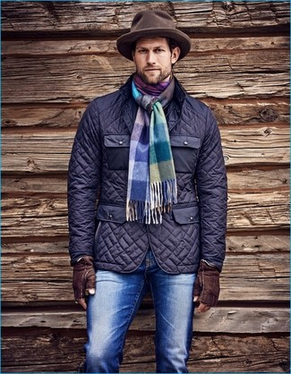 How to wear: navy quilted field jacket, blue jeans, brown wool hat, multi colored plaid scarf