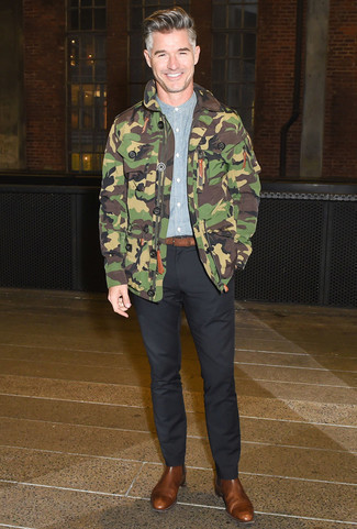 How to Wear a Brown Leather Belt For Men: If you're hunting for a casual street style yet dapper look, reach for an olive camouflage field jacket and a brown leather belt. To introduce a bit of depth to this getup, introduce a pair of brown leather chelsea boots to your outfit.