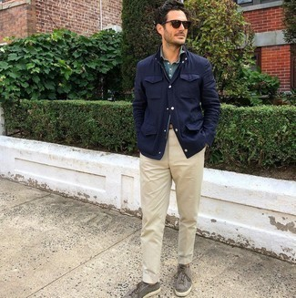 Light Blue Chambray Long Sleeve Shirt Outfits For Men: Choose a light blue chambray long sleeve shirt and beige chinos to assemble an interesting and modern-looking casual outfit. A pair of grey suede low top sneakers will add a new depth to an otherwise mostly dressed-up getup.