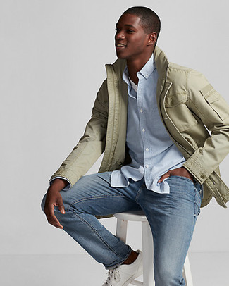 How to wear: olive field jacket, light blue chambray long sleeve shirt, white crew-neck t-shirt, blue jeans