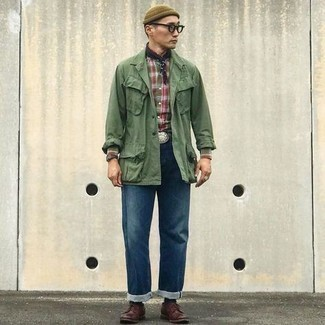 Dark Brown Leather Derby Shoes Outfits: Marry an olive field jacket with navy jeans to feel completely confident in yourself and look stylish. And if you need to instantly ramp up your ensemble with a pair of shoes, why not complete this look with dark brown leather derby shoes?