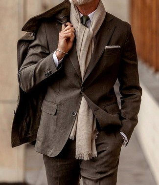 How to wear: dark brown leather field jacket, dark brown suit, white dress shirt, dark green tie