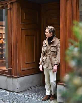 Khaki Field Jacket Outfits: You're looking at the definitive proof that a khaki field jacket and white dress pants look amazing if you wear them together in an elegant ensemble for a modern dandy. When not sure as to the footwear, add brown suede chelsea boots to the equation.