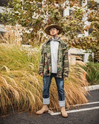 Tan Suede Chelsea Boots Outfits For Men: You'll be amazed at how super easy it is for any guy to pull together this off-duty look. Just an olive camouflage field jacket worn with navy patchwork jeans. You can get a little creative on the shoe front and dress up your look by rocking a pair of tan suede chelsea boots.