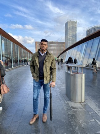 Blue Skinny Jeans Outfits For Men: This combination of an olive field jacket and blue skinny jeans is extremely easy to imitate and so comfortable to rock a version of as well! Rounding off with a pair of tan leather casual boots is a guaranteed way to bring some extra classiness to your look.