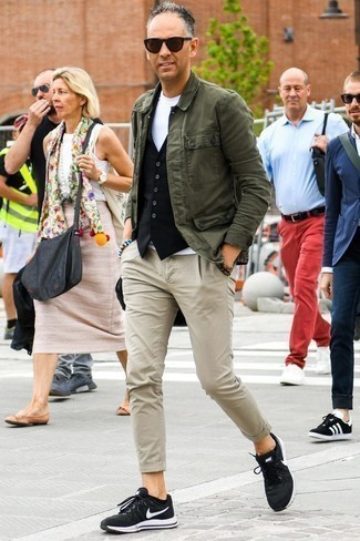 How to Wear a Black Waistcoat: Swing into something elegant and timeless in a black waistcoat and beige chinos. For an on-trend hi/low mix, complement your ensemble with a pair of black athletic shoes.