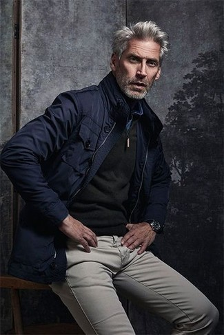 How to Wear a Blue Denim Shirt For Men: This combo of a blue denim shirt and grey chinos is simple, stylish and extremely easy to copy.