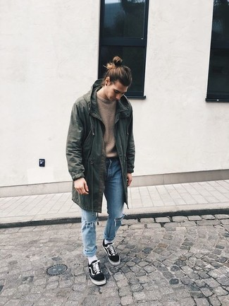 How to wear: olive fishtail parka, tan crew-neck sweater, light blue ripped jeans, black low top sneakers