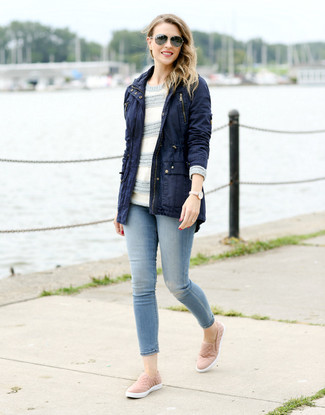 How to wear: navy fishtail parka, grey horizontal striped crew-neck sweater, light blue skinny jeans, pink slip-on sneakers