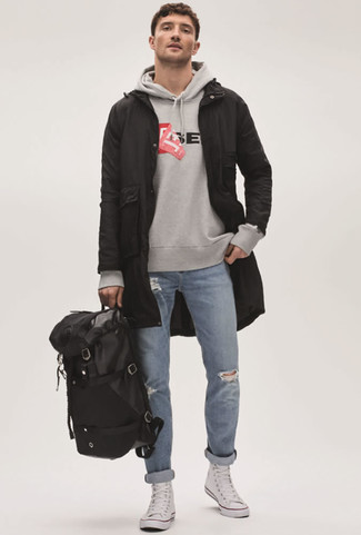 How to wear: black fishtail parka, grey print hoodie, light blue ripped jeans, white canvas high top sneakers