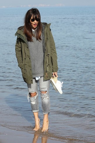How to Wear Grey Ripped Skinny Jeans: Stay chic and comfy on busy days by wearing an olive fishtail parka and grey ripped skinny jeans. As for footwear, choose a pair of white leather low top sneakers.