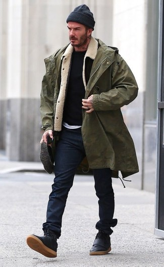 How to wear: olive fishtail parka, black and white shearling jacket, black crew-neck sweater, white crew-neck t-shirt