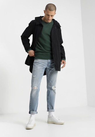 Consider teaming a black fishtail parka with light blue ripped jeans for a comfy-casual look. Take a classic approach with the footwear and choose a pair of white leather low top sneakers. This getup is absolutely great to welcome the springtime.