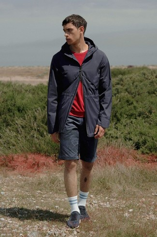 How to wear: black fishtail parka, red sweatshirt, black shorts, charcoal low top sneakers